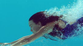 Woman Swimming Underwater In Slow Motion Royalty-free stock video